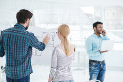 Young team of architects working together in office Stock Photography
