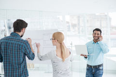 Young team of architects working together in office Stock Photo