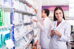 Young team in chemist shop Stock Photos