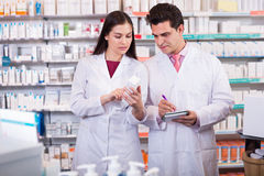 Young team in chemist shop Stock Images