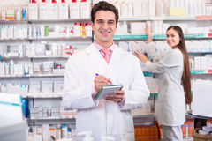 Young team in chemist shop Royalty Free Stock Image