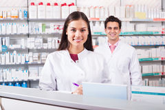 Young team in chemist shop Royalty Free Stock Images
