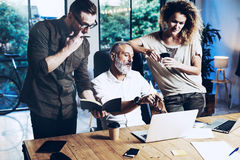 Young team of coworkers making great work discussion in modern office.Bearded man talking with account director and Royalty Free Stock Images