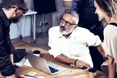 Young team of coworkers making great work discussion in modern office.Bearded man talking with marketing director and royalty free stock images