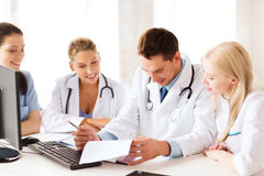 Young team or group of doctors on meeting. Healthcare and medical concept - young team or group of doctors on meeting Royalty Free Stock Photos