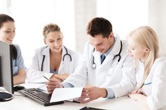 Young team or group of doctors on meeting. Healthcare and medical concept - young team or group of doctors on meeting Stock Photos