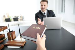 Young team of lawyers. At workplace Stock Image
