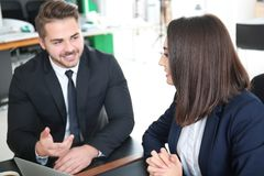 Young team of lawyers. At workplace Stock Photos
