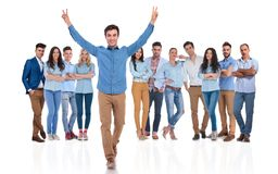 young team leader celebrating success of group whil walking forward royalty free stock photos