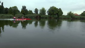 Young team members training in a kayak. Zabalj;Serbia; 08.03.2016.National team rowers in a kayak on the preparations for the Summer Olympic Games 2016. Video stock video footage
