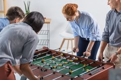 Young team playing table football Royalty Free Stock Images