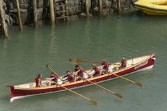 Young team on rowing boat at Clovelly, Devon Stock Images