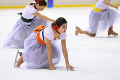 Young team from a school of skating on ice performs, disguised as flamenco dancers Royalty Free Stock Photography