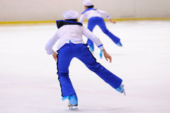 Young team from a school of skating on ice performs, disguised as sailors Royalty Free Stock Photos