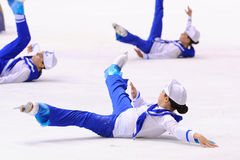 Young team from a school of skating on ice performs, disguised as sailors Stock Photography