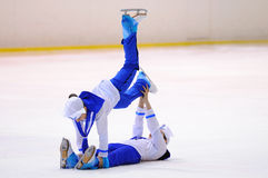Young team from a school of skating on ice performs, disguised as sailors Stock Photos