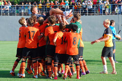 Young team Shakhtar raises his coach Stock Image
