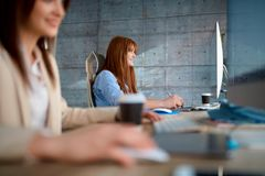 Young team working at office - women designers working royalty free stock photo