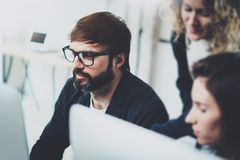 Young team working together in meeting room at office.Coworkers brainstorming process concept.Horizontal.Blurred stock photo