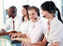 Young team working together in an office Stock Images