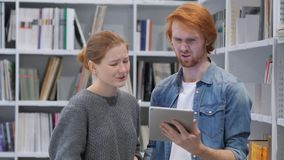 Young Teammates Reacting to Loss Email on Tablet PC, Upset royalty free stock images