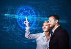 Young tech couple pressing high technology Stock Images