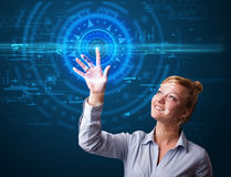 Young tech woman pressing high technology control panel screen c Royalty Free Stock Image