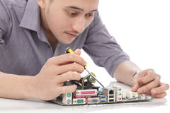 young technician fixing computer hardware Royalty Free Stock Images