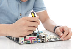 young technician fixing computer hardware Royalty Free Stock Photography