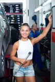 Young technician girl working in car workshop Royalty Free Stock Image