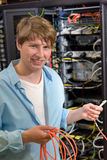 Young technician holding optical cable in datacenter Royalty Free Stock Photo