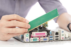 young technician unstalling ram memory to motherboard Royalty Free Stock Photography