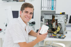 Young technician working on broken computer Stock Photography