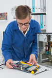Young technician working on broken cpu Royalty Free Stock Image