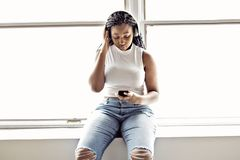 Young Teen Beautiful African American Woman Enjoys Listening To Music With Headphones Stock Images