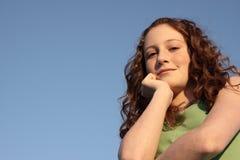 Young teen on blue Stock Photos
