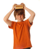 Young teen boy with books Stock Images