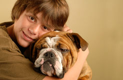 Young teen boy and bulldog Stock Photo