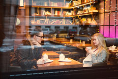 Young teen boy-girl couple, on date gazing into each other. In restaurant royalty free stock images