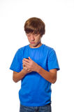 Young teen boy looking at cell phone Royalty Free Stock Photos