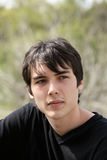 Young teen boy outdoor portrait black hair Royalty Free Stock Photo
