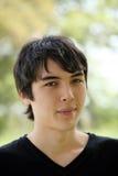 Young Teen boy outdoor portrait dark hair Stock Images