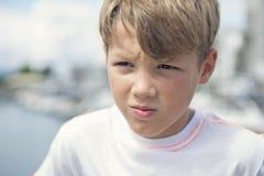 Young teen boy standing on the beach Stock Photos