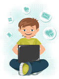 Young teen boy working on a laptop Royalty Free Stock Photography