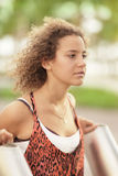Young teen in the car. Beautiful young female in a park setting Stock Photography