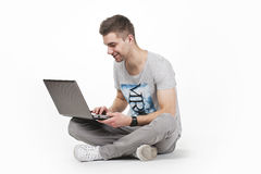 Young teen with computer Royalty Free Stock Photos