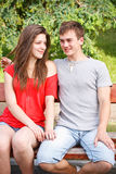 Young teen couple on a bench Stock Image