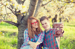 Young teen couple with camera Royalty Free Stock Images
