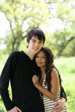 Young teen couple holding each other outdoors Stock Photos