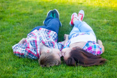 Young teen couple kissing Stock Images